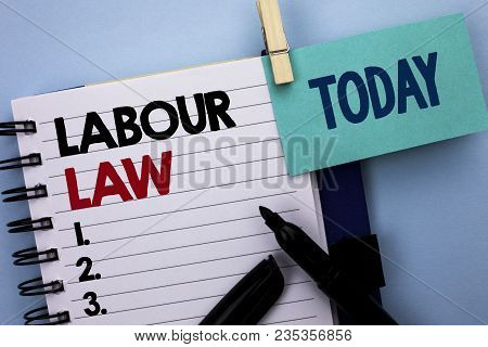 Conceptual hand writing showing Labour Law. Business photo text Employment Rules Worker Rights Obligations Legislation Union written Notebook Book plain background Today Marker next to it poster