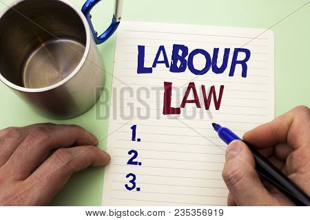 Writing note showing  Labour Law. Business photo showcasing Employment Rules Worker Rights Obligations Legislation Union written by Man Notebook Paper Holding Marker plain background Cup. poster