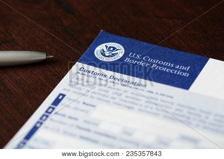 New York, Usa - Mapril 9, 2018: Close-up Of Customs Declaration Form Laying On Wooden Table