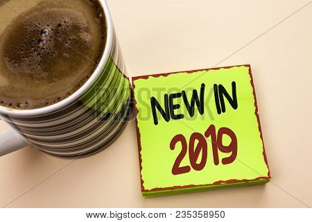 Word writing text New In 2019. Business concept for Fresh Era Latest Year Period Season Annual Coming Modern written Green Sticky Note Paper the plain background Coffee Cup next to it. poster