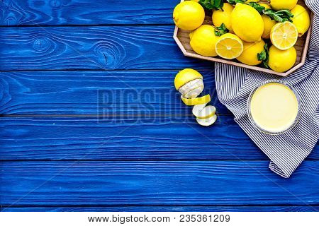 Lemon Curd. Sweet Cream For Desserts Near Lemons In Tray On Blue Wooden Background Top View.