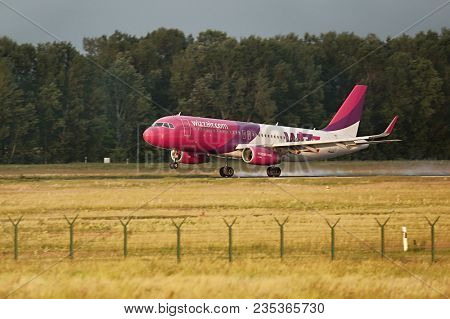 BUDAPEST, HUNGARY - MAY 5, 2014: Wizzair A320 landing at Budapest Liszt Ferenc Airport. Budapest is one of Wizzair's most important bases.