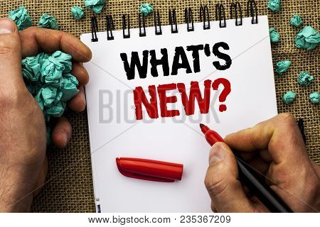 Conceptual hand writing showing What s New Question. Business photo text Asking Questionaire Inquiry Problem Questioning written by Man Holding Marker Notebook Book jute background poster