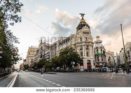Madrid, Spain - November 3, 2017:  Gran Via Street And Metropolis Building In Madrid At Sunset.