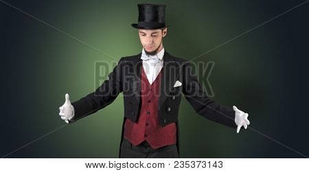 Handsome magician with no graph holds something invisible