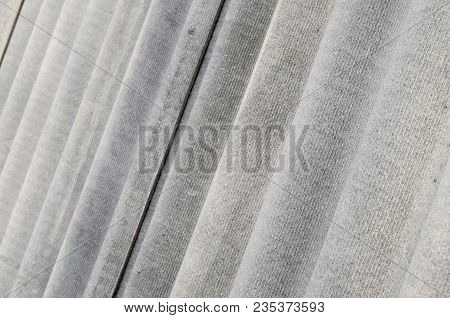 The Texture Of An Old Asbestos House Roof In A Village Or An Old Painted Fence Of Shiver Slate