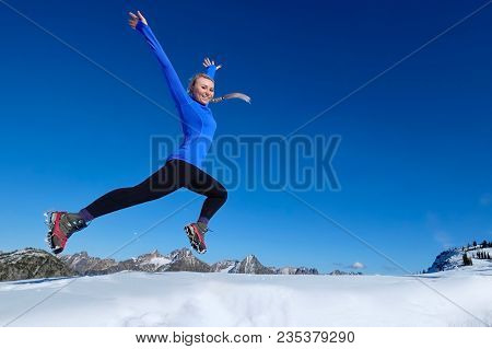 Happy Jumping. Young Pretty Girl Jumping In Mountains. Jumping With Joy.  Crater Lake. Oregon. Unite