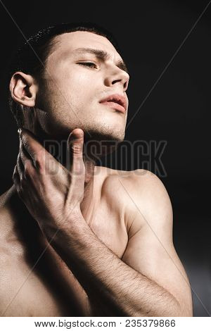 Side View Confused Man Having Pain In Neck. He Keeping It By Hand. Disturbance Concept