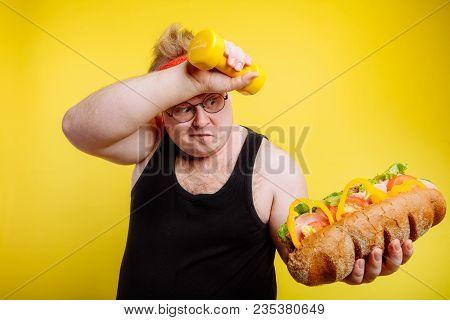 Fatigued Funny Fat Man Sweats While Lifting Burger