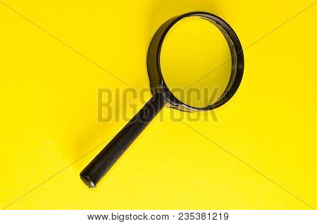 Vintage Magnify Glass Loupe On A Colored Background