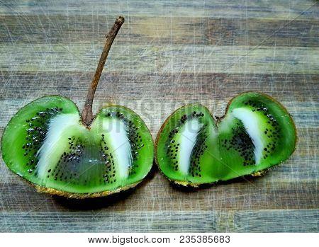 Close Up Of Kiwi Interesting Form. Healthy Fruit - Organic Kiwi. Sliced Fresh Juicy Kiwi Two Half. K