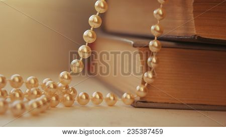 Gift Jewelry For Women - Beautiful Golden Pearls. Beautiful Bright Rustic Background With Golden Pea