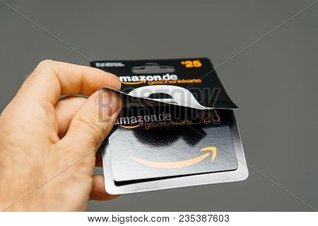 Paris, France - Apr 1, 2018: Man Opening 25 Euros Amazon Gift Card Issued By Amazon Germany, Valid I