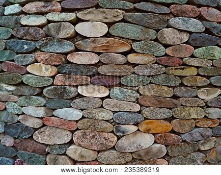 Cut Pebble Stone Texture Wall Floor Colorful Background. Wall Made From Cut Pebble Gravel Stones Dif