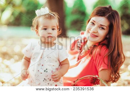 The Daughter And Her Mother In The Park, Close-up Portrait.