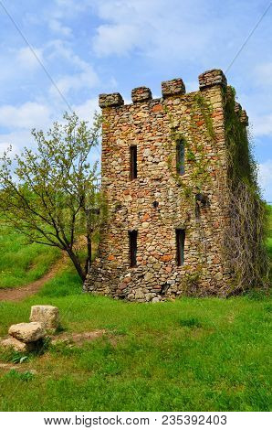 Old Castle Ruin In Sunny Spring Day & Blue Sky. Exterior Rock Brick Wall Of Ancient Palace. Castle S