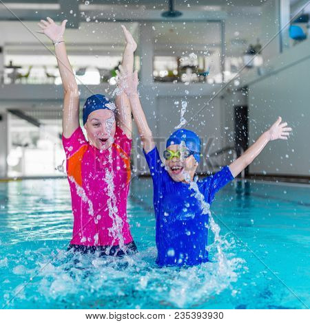 Swimming School. Cute Little Boy Having Fun With Swimming Instructor