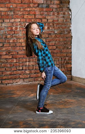 Portrait Full Growth Young Stylish Hipster Teenager Girl On Brick Wall Background. Model Tests Cauca