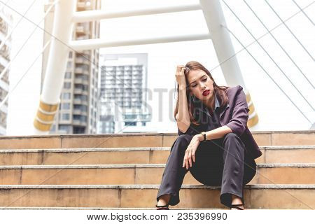 Unemployed Of Businesswoman Sit On The Stair