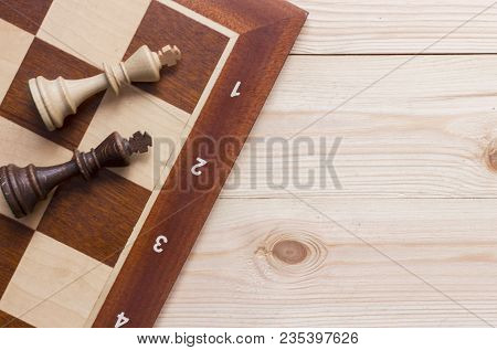 Chess Board Game On Wooden Background Top View Copy Space