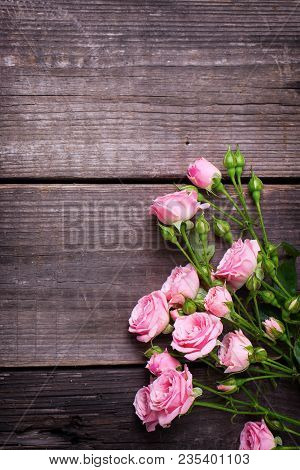 Border From Tender Pink Roses Flowers  On Vintage Wooden Background. Floral Still Life.  Top View.se