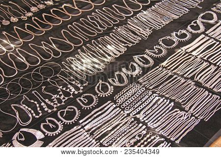 Tibetan Silver Is On The Market In India, Anjuna. Silver Bracelets And Necklaces Are Sold On The Mar