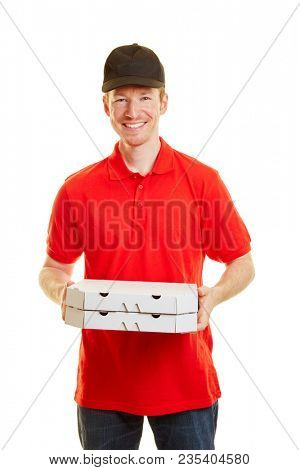 Pizza delivery guy standing with two pizzas and smiling