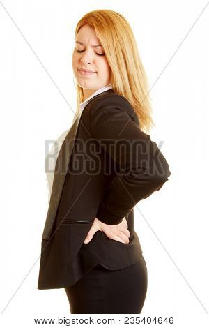 Businesswoman with back pain holding her hands on her back