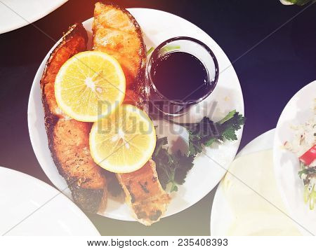 Fried Salmon And Cup Of Wine  On The  Table. Georgian Cuisine On The Wooden Table. Georgian Cuisine.