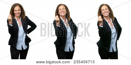 Middle age business woman angry gesturing typical italian gesture with hand, looking to camera over white background