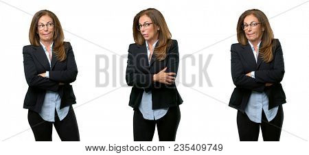 Middle age business woman nervous and scared biting lips looking camera with impatient expression, pensive over white background