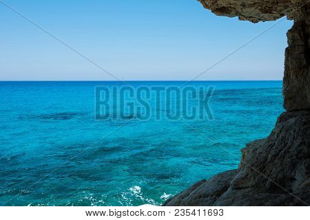 Idyllic Sea View From A Cave