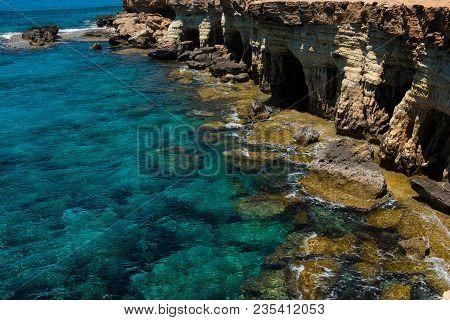 Rocky Coastline And Sea Caves