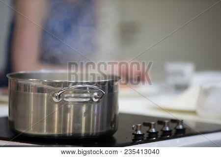 Saucepot With Hot Water And Steam.metal Casserole With Food