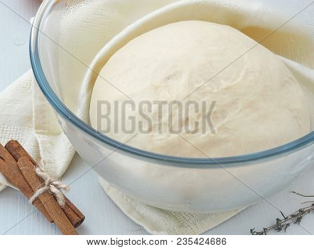 Cooking Process. Leavened Fresh Dough In Misted Bowl. Preparing Dough For Cakes, Pastries, Buns Or P