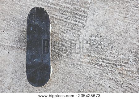 Skateboard On Cement Floor With Vintage View.