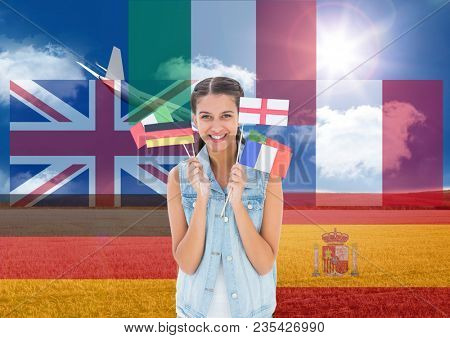main language flags around young woman with flags with plane behind in field