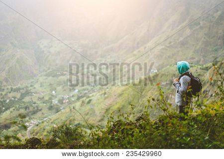 A Tourist With Backpack Admire The Rural Landscape With Mountain Ridge In Xo-xo Valley. Santo Antao