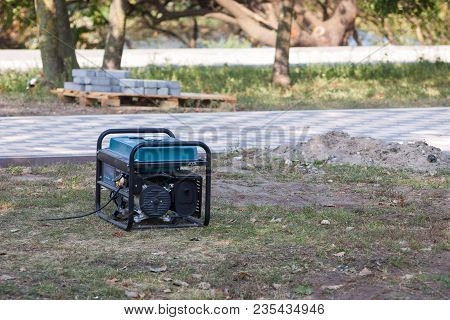 Gasoline portable generator on the street. Close up on mobile backup generator .Standby generator -