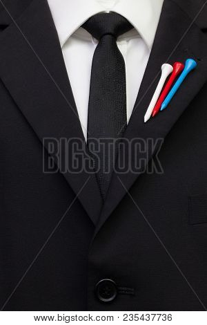The Detail Of Wedding Suit With Golf Design.golf Tees In The Color Of The Russian    Flag On The Fla