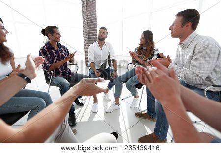 creative team applauding the speaker