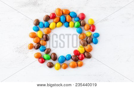 Colorful Round Candies On White  Background With Copy Space. Different Small Colored Candies. Top Vi