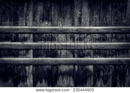 Old Blacked Knotty Wood Texture With Transverse Boards. Dark Wooden Background Of Weathered Aged Pla