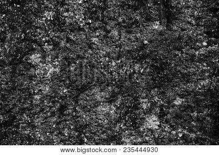 Black Glossy Textured Surface. Dark Abstract Relief Background