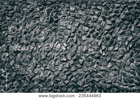 Black Stone Wall Texture With Traces Of White Paint. Grunge Background