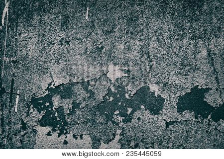 Old Shabby Concrete Wall Texture With Cracked Detached Paint. Gloomy Gray Grunge Background