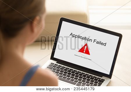 Girl Looking At Laptop With Application Failed Error On Screen. Software Failure, App Stopped Workin