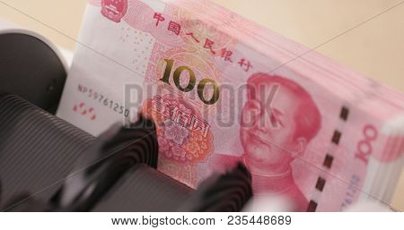 Money counting machine with Chinese hundred RMB