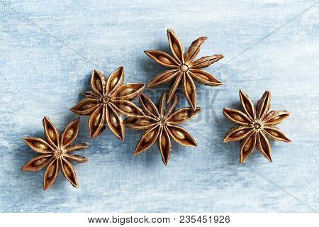 Star anise, spice fruits and seeds on wooden background. Food background. Top view.