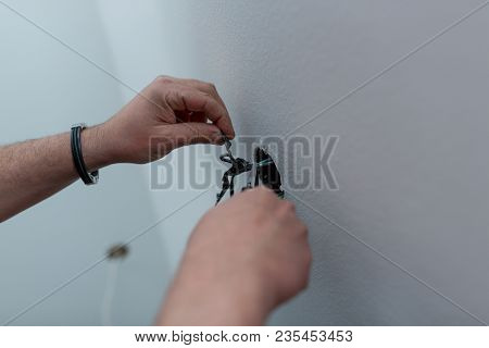Professional Electrician Stripping The Cable To Connect Switches And Sockets Of A Residential Electr